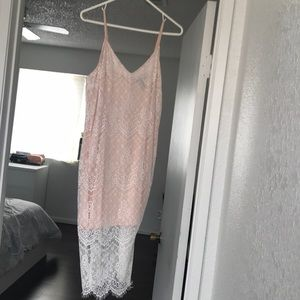 White lace dress with a pink undergarment
